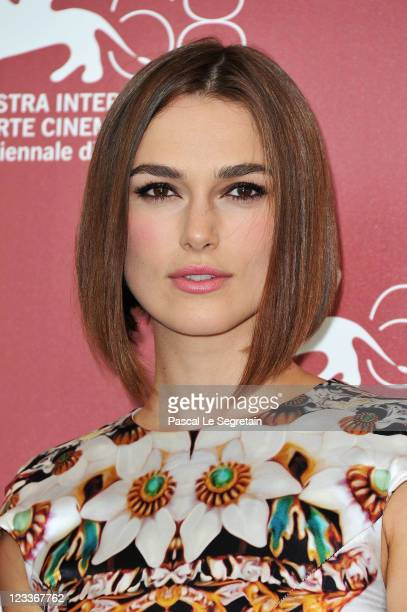 Actress Keira Knightley poses at the 'A Dangerous Method' photocall at the Palazzo del Cinema during the 68th Venice Film Festival on September 2...
