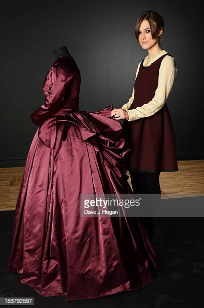 Actress Keira Knightley poses with the costume she wore in the film Anna Karenina It will be featured in the new Hollywood Costume exhibition at the...