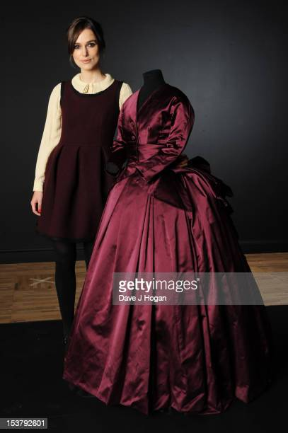 Actress Keira Knightley poses with the costume she wore in the film Anna Karenina. It will be featured in the new Hollywood Costume exhibition at the...