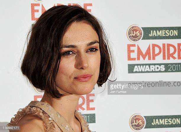Actress Keira Knightley, winner of Empire Hero, poses in the press room at the Jameson Empire Awards at The Grosvenor House Hotel on March 27, 2011...