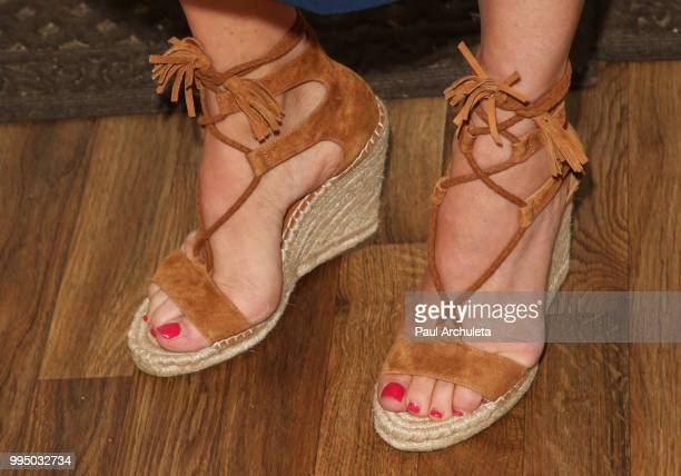 Actress Kelley Limp Shoe Detail visits Hallmark's Home Family at Universal Studios Hollywood on July 9 2018 in Universal City California
