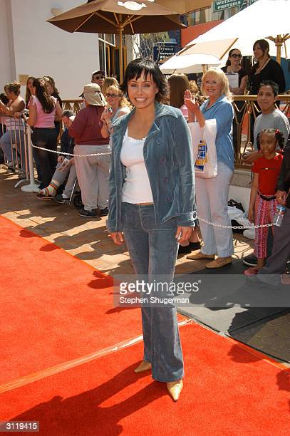 Actress Kelli McCarty poses during the second day of NBC's Fan Festival 2004 held on March 21, 2004 at Universal City Walk, in Hollywood, California.