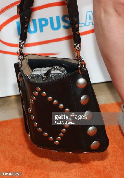 Actress Kellie Martin handbag detail attends the Lupus LA 2019 Hollywood Bag Ladies Luncheon at The Beverly Hilton Hotel on November 22 2019 in...