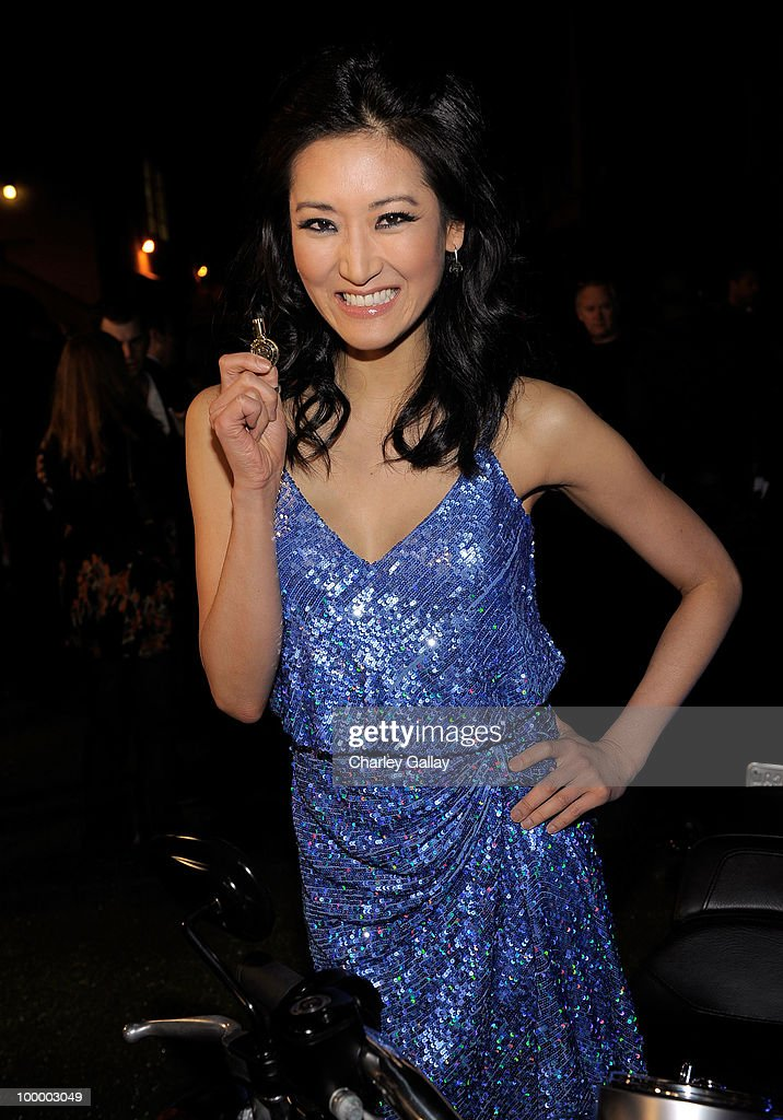 Actress Kelly Choi turns the key on a Harley-Davidson to raise money for Harley�s Heroes at the 2010 Maxim Hot 100 Party held at Paramount Studios on May 19, 2010 in Los Angeles, California.