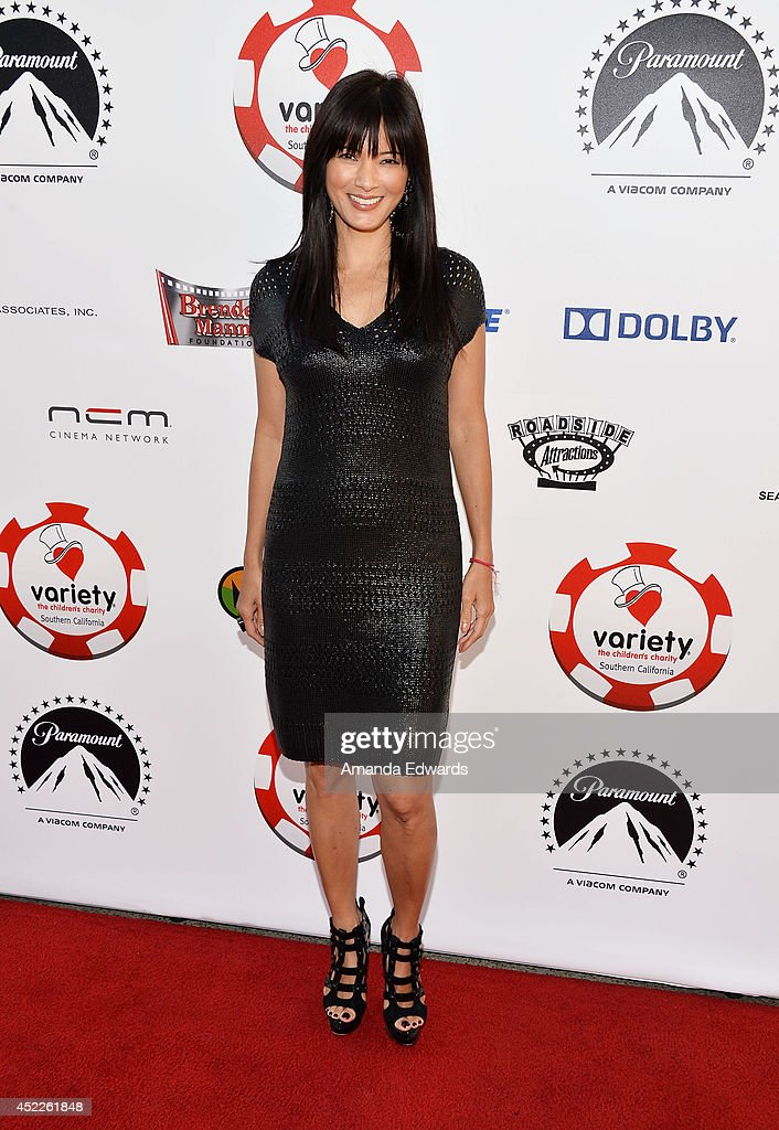 Actress Kelly Hu arrives at the 4th Annual Variety - The Children's Charity of Southern CA Texas Hold 'Em Poker Tournament at Paramount Studios on July 16, 2014 in Hollywood, California.