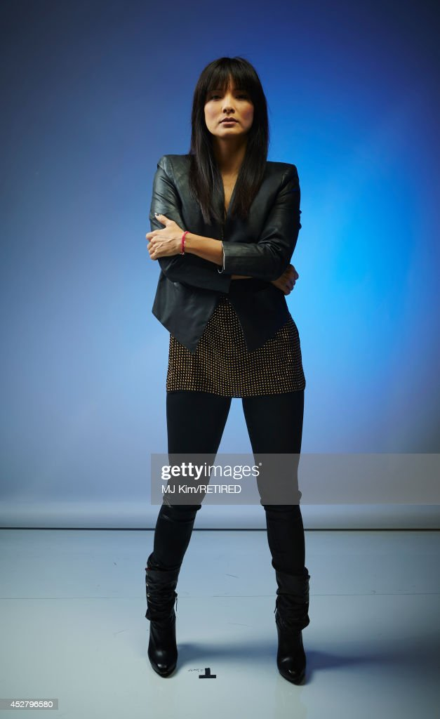 Actress Kelly Hu poses for a portrait at the Getty Images Portrait Studio Powered By Samsung Galaxy at Comic-Con International 2014 at Hard Rock Hotel San Diego on July 27, 2014 in San Diego, California.