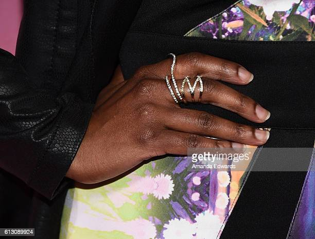 """Actress Kelly Jenrette, ring detail, arrives at the premiere of HBO's """"Insecure"""" at the Nate Holden Performing Arts Center on October 6, 2016 in Los..."""