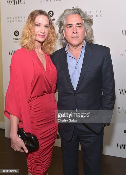 Actress Kelly Lynch and actor/producer Mitch Glazer attend VANITY FAIR and Barneys New York Dinner benefiting OXFAM hosted by Rooney Mara at Chateau...