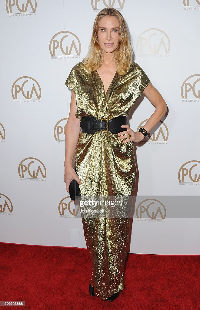Actress Kelly Lynch arrives at the 27th Annual Producers Guild Awards at the Hyatt Regency Century Plaza on January 23, 2016 in Century City, California.