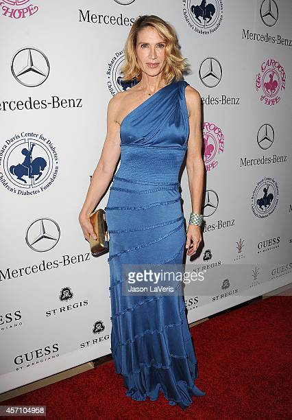 Actress Kelly Lynch attends the 2014 Carousel of Hope Ball at The Beverly Hilton Hotel on October 11 2014 in Beverly Hills California