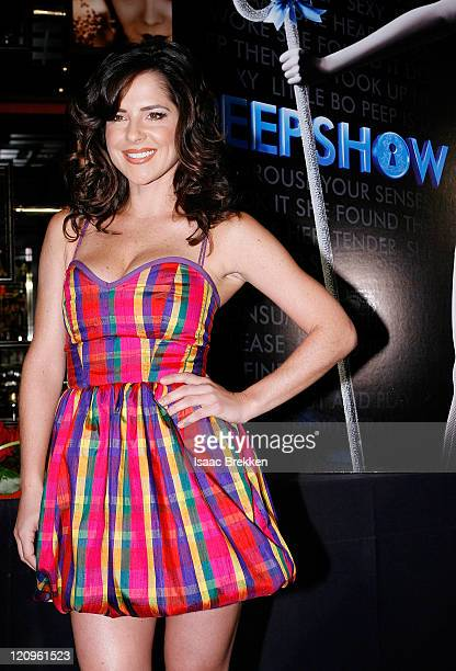 Actress Kelly Monaco poses for photos following a news conference announcing the new production 'Peepshow' at Planet Hollywood Resort Casino November...