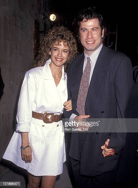 Actress Kelly Preston and actor John Travolta attend the 'Hudson Hawk' Westwood Premiere on May 20 1991 at Mann National Theatre in Westwood...