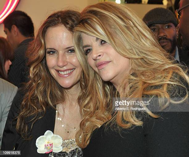 Actress Kelly Preston and actress Kirstie Alley attend the opening of Kirstie Alley's Organic Liaison Store on March 9 2011 in Los Angeles California