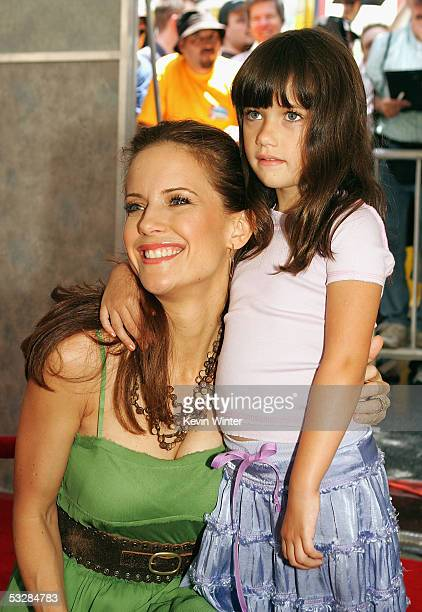 """Actress Kelly Preston and daughter arrive at the premiere of """"Sky High"""" at the El Capitan Theater on July 24, 2005 in Hollywood, California."""