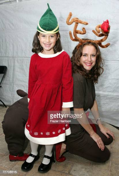 Actress Kelly Preston and daughter Ella Bleu Travolta pose backstage at the Church of Scientology's Christmas Stories XIV An Evening of Holiday Joy...