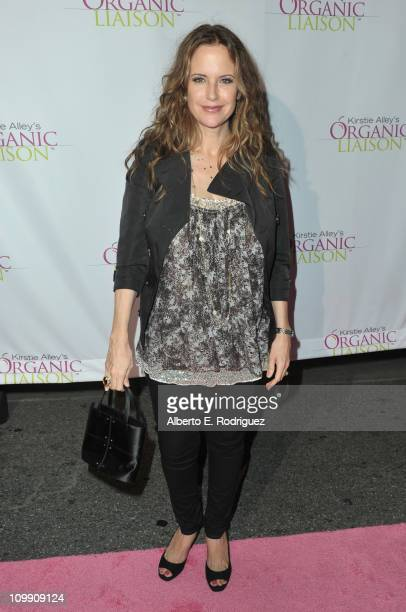 Actress Kelly Preston arrives to the opening of Kirstie Alley's Organic Liaison Store on March 9 2011 in Los Angeles California