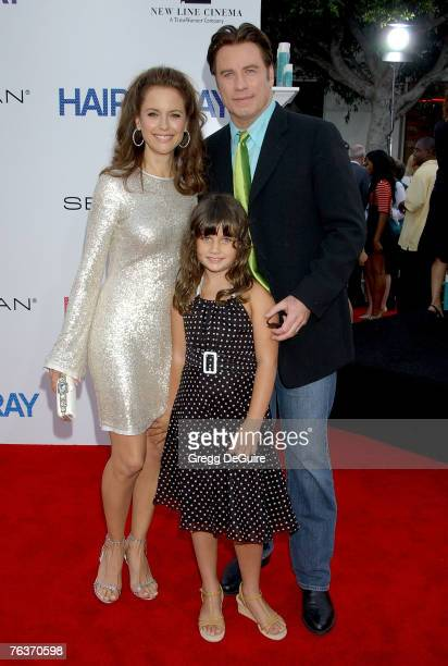 Actress Kelly Preston daughter Ella Bleu and actor John Travolta arrive at the Hairspray premiere at the Mann Village Theatre on July 10 2007 in...