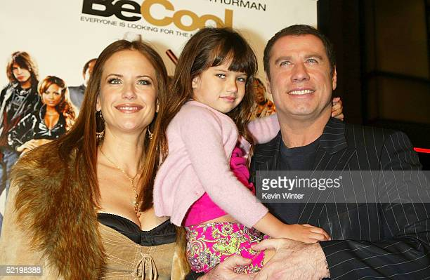 """Actress Kelly Preston, daughter Ella Bleu and actor John Travolta walk on the red carpet during MGM's premiere of """"Be Cool"""" at Grauman's Chinese..."""