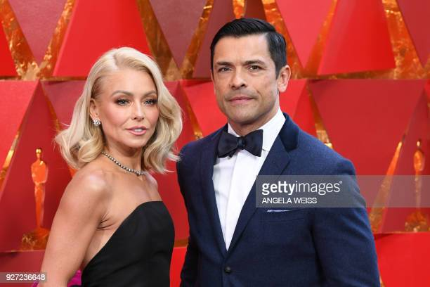US actress Kelly Ripa and her husband Mark Consuelos arrive for the 90th Annual Academy Awards on March 4 in Hollywood California / AFP PHOTO /...