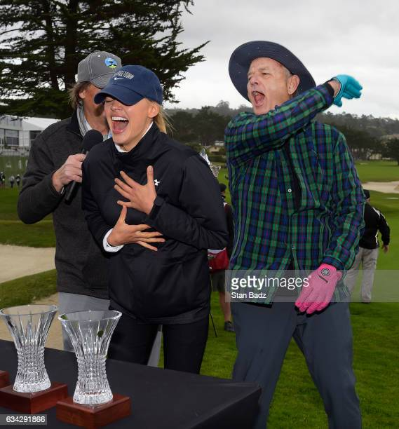 Actress Kelly Rohrbach and comedian Bill Murray celebrate after winning the 3M Celebrity Challenge at the ATT Pebble Beach ProAm at Pebble Beach Golf...