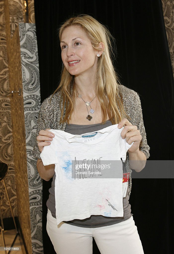 Actress Kelly Rtherfordd in Alice + Olivia attends Alice + Olivia Tea Party Benefitting Children's Defense Fund on May 23, 2010 in Los Angeles California.