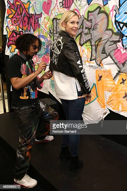 Actress Kelly Rutherford and Le H attend the Faith Connexion Street Art Tour hosted by Saks Fifth Avenue and Marie Claire at Saks Fifth Avenue on...