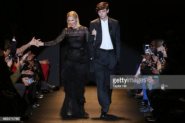 Actress Kelly Rutherford and model Trevor Feehan walk the runway during Naomi Campbell's Fashion For Relief 2015 fall fashion show at The Theater at...