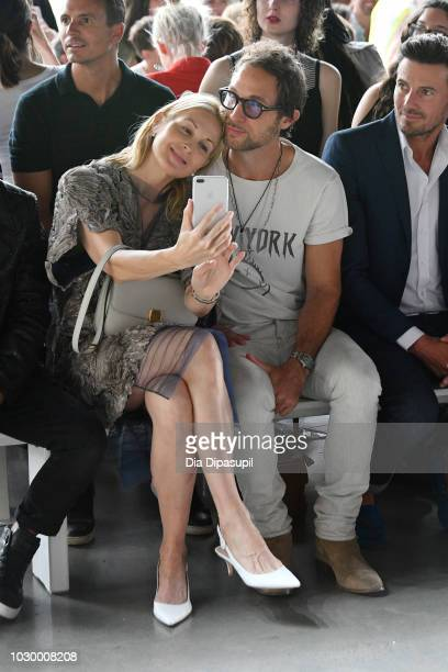 Actress Kelly Rutherford Anthony Giovanni Deane and Alex Lundqvist attend the Son Jung Wan Front Row during New York Fashion Week The Shows at...