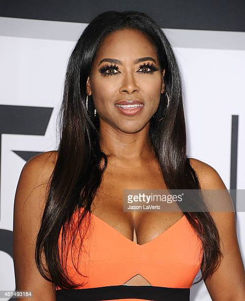 Actress Kenya Moore poses in the press room at the 2014 BET Awards at Nokia Plaza LA LIVE on June 29 2014 in Los Angeles California
