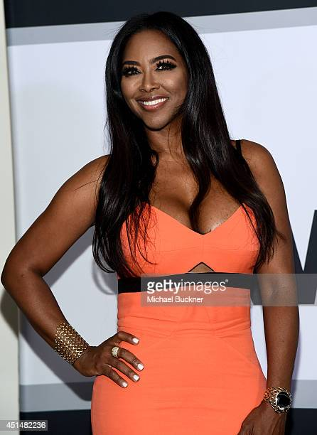 Actress Kenya Moore poses in the press room during the BET AWARDS '14 at Nokia Theatre LA LIVE on June 29 2014 in Los Angeles California