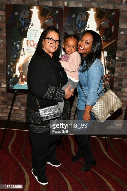 Actress Keshia Knight Pulliam poses with her daughter Ella Grace and her mother Denise Pulliam during Netflix's Klaus Atlanta screening at Cinebistro...