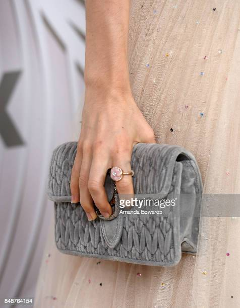 Actress Kiernan Shipka clutch and ring detail arrives at the FOX Broadcasting Company Twentieth Century Fox Television FX and National Geographic...