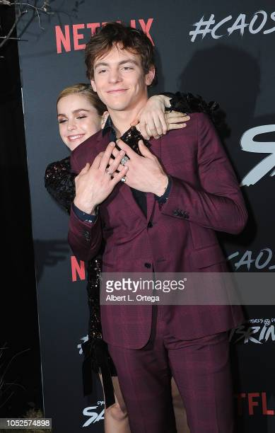 Actress Kiernan Shipka photobombs costar/actor Ross Lynch at the Premiere Of Netflix's 'Chilling Adventures Of Sabrina' held at The Hollywood...