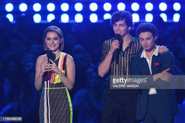 US actress Kiernan Shipka US actor Ross Lynch and US actor Gavin Leatherwood arrive to present the nominees for Best Kiss during the 2019 MTV Movie...