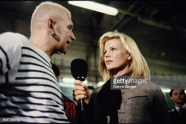 Actress Kim Basinger and French fashion designer Jean-Paul Gaultier on the set of the film Prêt-à-Porter, , directed by American director Robert...