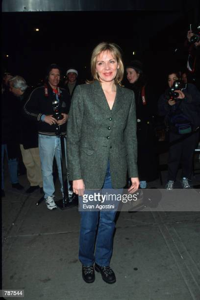 Actress Kim Cattrall poses for a picture outside the premiere of ''Earthly Possessions'' March 16 1999 in New York City The film is based on the...