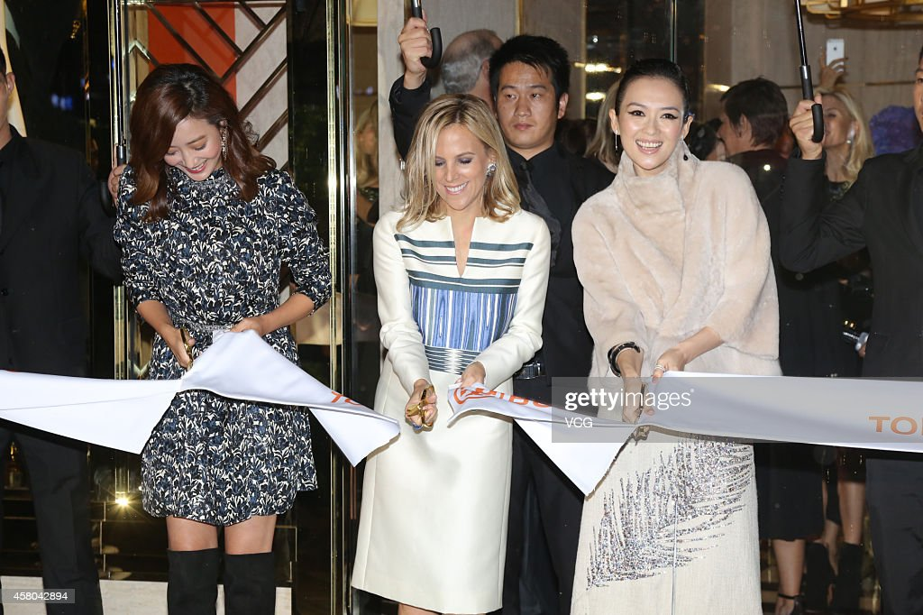Actress Kim Hee-Seon, designer Tory Burch and actress Zhang Ziyi attend Tory Burch flagship store opening ceremony at Kerry Center on October 29, 2014 in Shanghai, China.