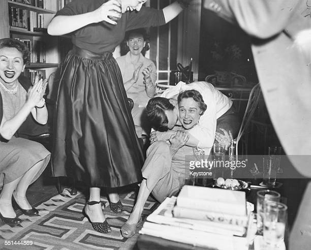 Actress Kim Hunter being hugged and kissed by her husband Robert Emmett as they celebrate her 'Best Actress' Academy Award win at their home in...