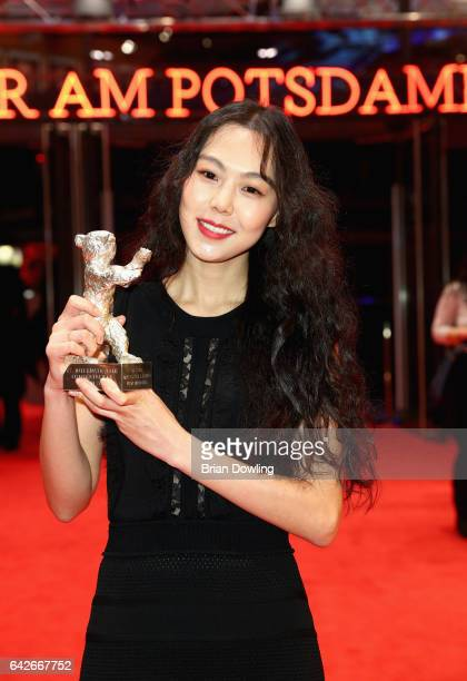 Actress Kim Minhee poses the Silver Bear award for best actress after the closing ceremony of the 67th Berlinale International Film Festival Berlin...