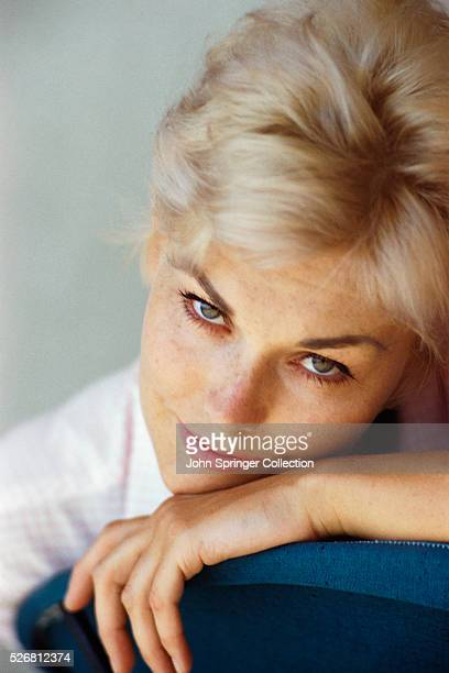 Actress Kim Novak Leaning Head on Back of Chair