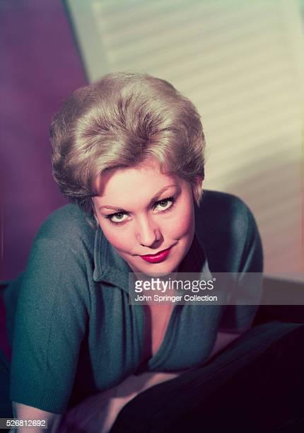 Actress Kim Novak Leaning on Chair