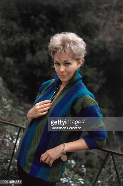 Actress Kim Novak poses for a portrait at home on November 26, 1958 in Los Angeles, California.