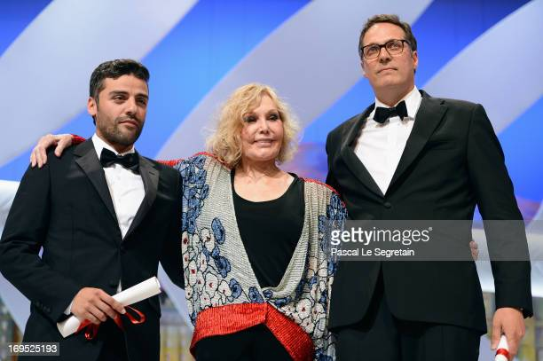 Actress Kim Novak poses with actor Oscar Isaac after he received for directors Joel and Ethan Coen the Grand Prix award for 'Inside Llewyn Davis' on...