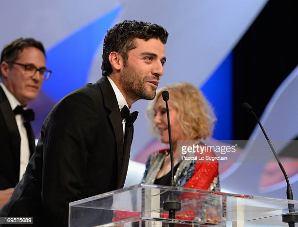 Actress Kim Novak stands near actor Oscar Isaac as he speaks after receiving for directors Joel and Ethan Coen the Grand Prix award for 'Inside...