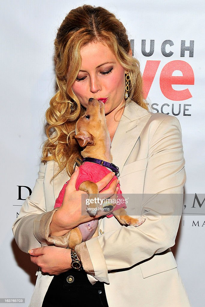 Actress Kim Poirier arrives at Dr. Davis B. Nguyen and Much Love Animal Rescue host ÒMakeover for MuttsÓ at The Peninsula Hotel at Peninsula Hotel on March 14, 2013 in Beverly Hills, California.