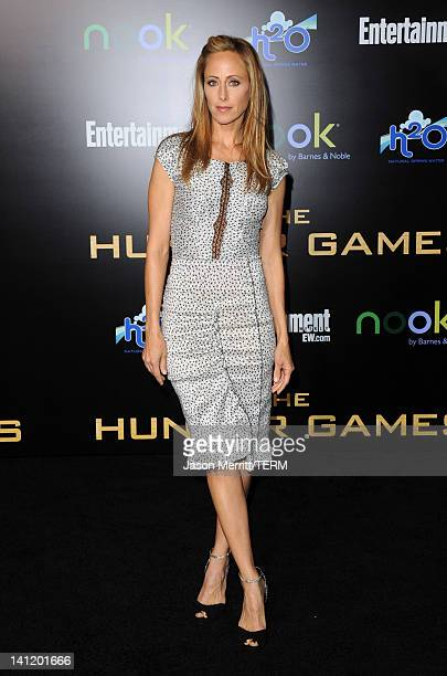 Actress Kim Raver arrives at the premiere of Lionsgate's The Hunger Games at Nokia Theatre LA Live on March 12 2012 in Los Angeles California
