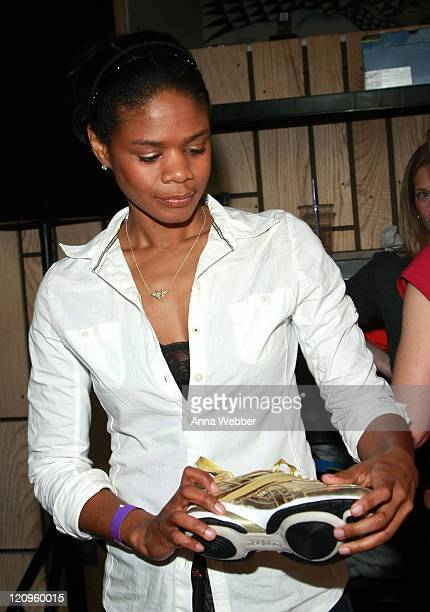 Actress Kimberly Elise poses at Reebok during the Kari Feinstein Golden Globes Style Lounge at Zune LA on January 14, 2010 in Los Angeles, California.