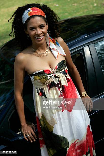 Actress Kimberly Huie poses with her BMW 325i in Los Angeles