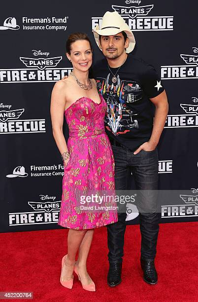 Actress Kimberly WilliamsPaisley and husband singer Brad Paisley attend the premiere of Disney's 'Planes Fire Rescue' at the El Capitan Theatre on...