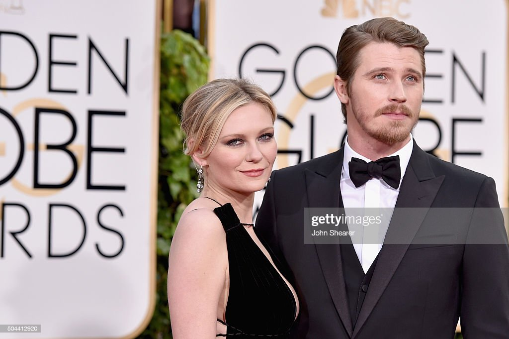 Actress Kirsten Dunst (L) and actor Garrett Hedlund attends the 73rd Annual Golden Globe Awards held at the Beverly Hilton Hotel on January 10, 2016 in Beverly Hills, California.